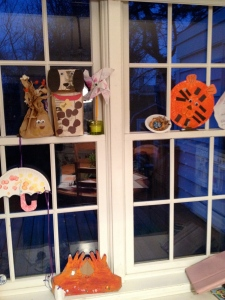 A proud parent sent me a photograph of all her daughters art projects hanging on the window.